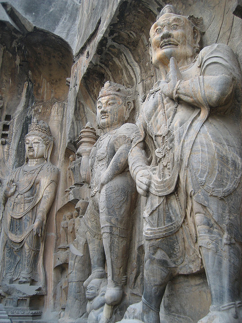 visitheworld:  Rock-carved statues at Longmen Caves in Henan, China (by bigguyoz).