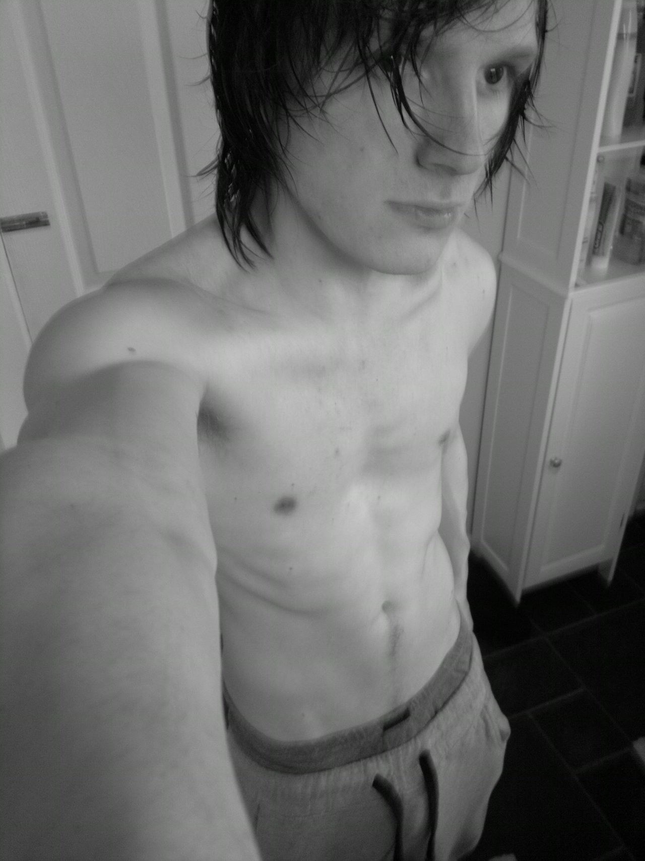 hey look im topless again ;D one day i'll  not be able to see my ribs :P oh and i need a hair cut badly