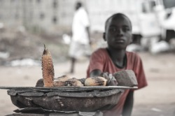 africaisdonesuffering:  Boy Selling Corn in Abuja Nigeria photo taken by Daniella Ekwueme tumblr: www.daniellaekwueme.tumblr.com
