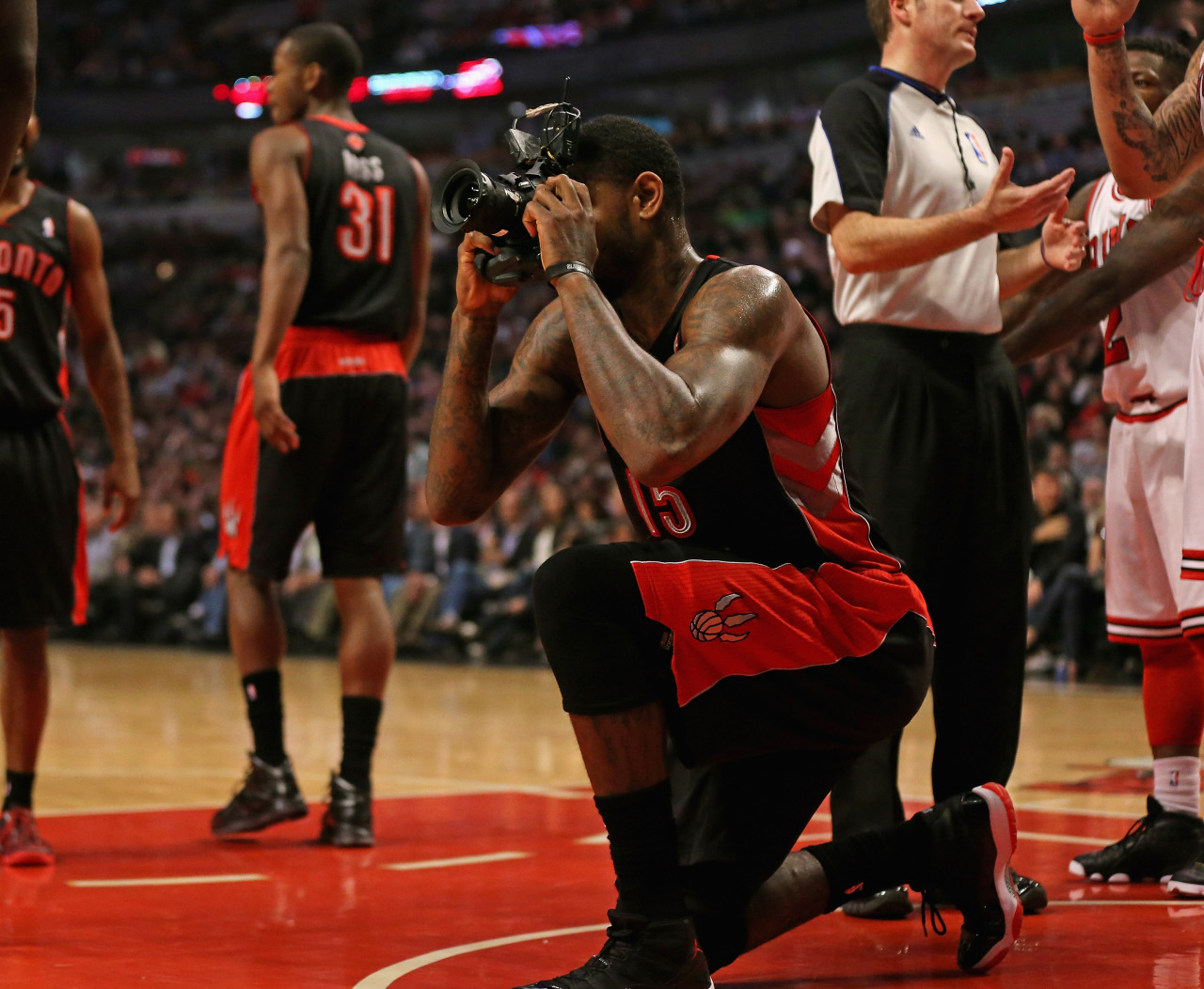 Amir Johnson has a new career? Great gem from USA Today Sports on how a photographer accidentally dropped his camera on the court — and the Raptors forward picked it up and took a few photos.