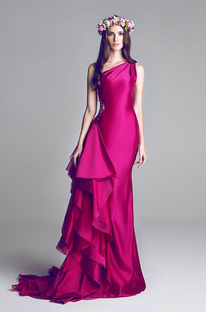 Hamda Al Fahim Spring/ Summer 2013 I have always been a fan on unconventional shapes in fashion. I think what makes this gown so successful is the combination of the colour, the cascade of fabric down one hip and the surface decoration which draws your eye to the curve of her waist.