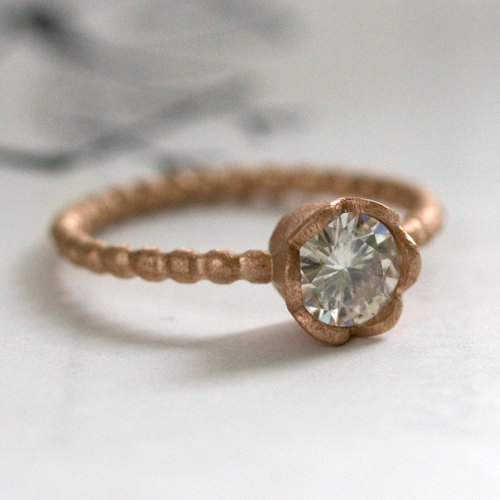 giftguide:  New #etsy #favorite: 15% OFF - 14 Karat Rose Gold and Moissanite Engagement Ring by NatashaKahnDesigns (725.00 USD) http://etsy.me/12KgqxC  I don't like gold for the most part but I love the classic romantic look of this