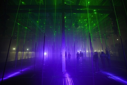 """Laser Forest, an interactive musical instrument which was commissioned for the STRP Biennale in Eindhoven. It's a huge forest of laser beams that features over 150 rods which can be tapped and played. By strumming and tapping them users can trigger both sounds and lasers and the piece becomes a collaborative instrument, as well as an otherwordly playground.""  check out the video here."