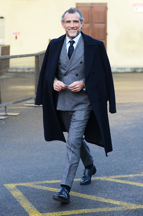 dapperedition:  Double-breasted suit, double-breasted overcoat, double monk straps: Double Style. The jacket fits him perfectly and the trousers are slim with classic turn-ups. The combination grey suit, white shirt and navy tie is your best friend in times where you don't know what to wear.