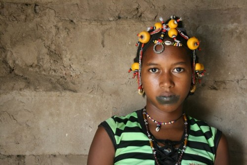Bineta Sow, 16 years old, was just married when this photograph was taken. Traditional Pulaar Jerri women braid beads into the hair of the bride, they are worn for up to a month after the week long wedding ceremony. Location: Ndiawene Peulh, Tambacounda, Senegal Photo and caption by  Emma Bunkley