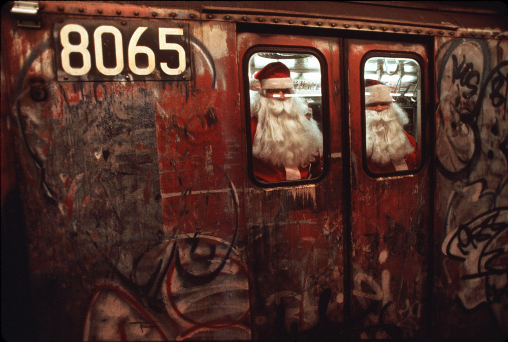 """© Misha Erwitt, 1988, New York City """"I never believed in Santa Claus because I knew no white dude would come into my neighborhood after dark."""" (Dick Gregory)"""