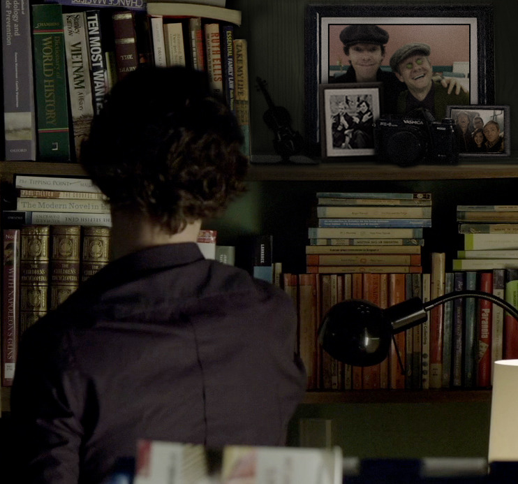 barachiki:  Sherlock peruses the bookshelf.
