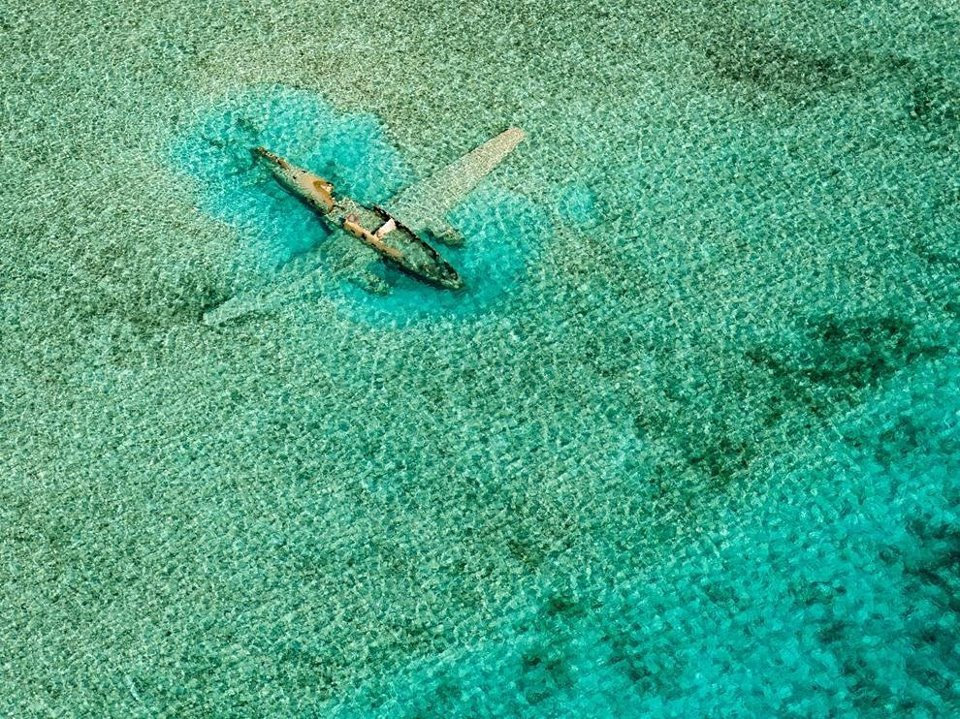 earth-phenomenon:  Submerged Plane, Bahamas Photographer's comment: While island hopping around the Bahamas in a Cessna C172 aircraft, I made this aerial of a Curtiss C-46 that ditched on November 15, 1980. It crashed while it was on a drug smuggling mission for the Colombian Medellín drug cartel and lies in shallow water east of the Norman's Cay airport in the Exumas, Bahamas.