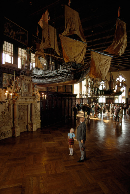 natgeofound:  Tourists in the old town hall of Bremen look up at a model ship in Germany, January 1969.Photograph by James P. Blair, National Geographic