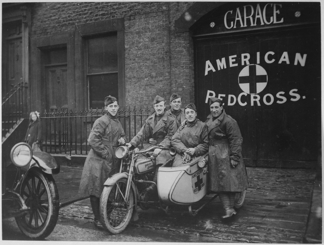 "American Red Cross in Great Britain. One unit of the famous ""Flying Squadron"" priding themselves on being able to get under way within three minutes of the time a call is received. American Red Cross., ca. 1918  Clara Barton founded the American Red Cross on May 21, 1881, after her experience with the International Red Cross in Europe, focused on providing disaster relief and support for military veterans, still core parts of their mission today."