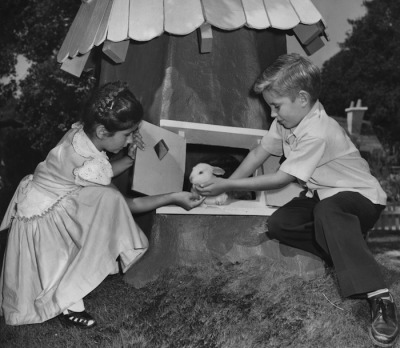 "HAPPY EASTER Oakland, CA September 2, 1950 - ""Peter Rabbit"" answers the door for cousins Diane and Stephen Russo at Children's Fairyland. (Jim Edelen / Oakland Tribune Staff Archives)"