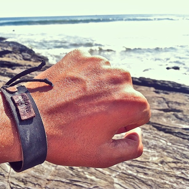 JB rockin' our Dedication black leather #lootb bracelet at the beach.  (at Playa Maderas, Nicaragua)