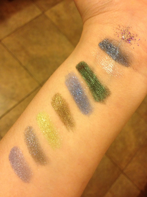 "Geek Chic Cosmetics swatches!  My Geek Chic order came in today and I am loving everything I got!  In order from top to bottom/right to left:  Glitter Grenades ""Plasma"" Solid Snake - their current color of the month Luck Dragon Everybody Lies Anarchist Priest Antediluvian (?? can't read the label, it was a freebie) Bonded to the Stars Blasphemous Game Over   Thoughts: My favorites are Luck Dragon, Everybody Lies and Anarchist Priest. My camera couldn't catch the awesomeness of these colors, they are all really amazing - Luck Dragon, which barely showed up for instance, is dazzling!! It is both opalescent and glittery, so very pretty. The green in Everybody Lies is drop dead gorgeous, I have been looking for a nice dark green and this is definitely it. Very happy with my purchase and will order again."