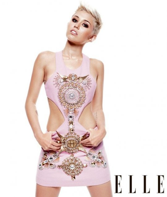 "MILEY CYRUS covers ELLE UK'S June Issue! The issue hit stands today (May 1st). Check out a few excerpts below: On Way She Shares Less On Social Media Now: ""We were too nice to the world and gave them too much insight — into my life and my puppies and my house — and I just don't feel they get that privilege anymore. Like on my Twitter, I'm much more … not conservative, but you don't see a picture of my dogs. You don't get that personal stuff anymore.""On Her Engagement:  ""We have a house together and dogs. It just seems right to be wearing this ring and to be committed. But we keep our relationship low-key and don't talk about it anymore."""