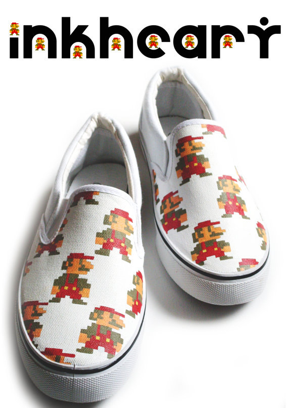gamerfashion101:  Handpainted Mario, Custom Shoes  £64.00 GBP  Approximately $101.99 USD Hand painted one of a kind kicks! This design features retro pixel mario! Be assured that these kicks are totally individual, you won't see anyone else in these! Purchase
