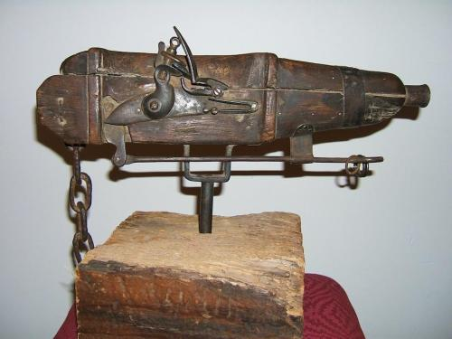 "Cemetery Gun: Invented to thwart grave robbers  In the 18th and 19th centuries, grave-robbing was a serious problem in Great Britain and the United States. Because surgeons and medical students could only legally dissect executed criminals or people who had donated their bodies to science (not a popular option at the time), a trade in illegally procured corpses sprang up. This cemetery gun, held in the Museum of Mourning Art at the Arlington Cemetery of Drexel Hill, Pa., was one dramatic strategy used to thwart so-called ""resurrection men.""   The gun, which the museum dates to 1710, is mounted on a mechanism that allows it to spin freely. Cemetery keepers set up the flintlock weapon at the foot of a grave, with three tripwires strung in an arc around its position. A prospective grave-robber, stumbling over the tripwire in the dark, would trigger the weapon—much to his own misfortune.   Grave-robbers evolved to meet this challenge. Some would send women posing as widows, carrying children and dressed in black, to case the gravesites during the day and report the locations of cemetery guns and other defenses. Cemetery keepers, in turn, learned to wait to set the guns up after dark, thereby preserving the element of surprise.   Because the guns were rented by the week and were prohibitively expensive to buy, the poorer people most likely to end up beneath the anatomist's knife—historian Michael Sappol writes that these included ""black people, criminals, prostitutes, the Irish, 'freaks,' manual laborers, indigents, and Indians""—probably wouldn't have benefited from this form of protection."