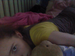 Me watching the Grim Adventures of Billy and Mandy with my teddy bear. (She's missing her pants D:)
