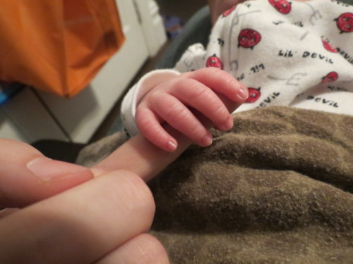 This is my nephew holding my finger. You can't handle the cute I have to deal with every single damn day.