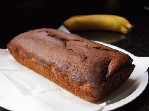 Italian Breakfast/ Banana bread —recipe after the jump— [[MORE]] Recipe by: Nigella Lawson Serves 8-10  Ingredients: 150ml vegetable oil, plus some for greasing (you'll also need baking paper to line the tin) 3 medium bananas, very ripe 2 tsp vanilla extract pinch of salt 2 eggs 150g caster sugar 175g plain flour 1/2 tsp bicarbonate of soda 4 tsp instant espresso powder Method: Preheat the oven to 170C/338F Line your loaf tin with baking paper. Dab and spread spots of oil onto the back of some baking paper to help it stick to the baking tin. Mash the bananas with vanilla extract and salt and then beat in the oil. Follow this by beating in the eggs, one by one followed by the sugar. Mix the flour with the bicarb soda and coffee, then beat into your banana batter. Pour the batter into the prepared loaf tin and bake for about 50-60 minutes. The load should be slightly coming away from the sides of the tin, with the top of the loaf bulging. Test the inside of the cake but sticking a skewer into the center, and it should come out  clean/dry. And that's that! :) Nigella suggests you wait at least half or a whole day before chowing some down, but as for me…that plan fell through. Enjoy! J