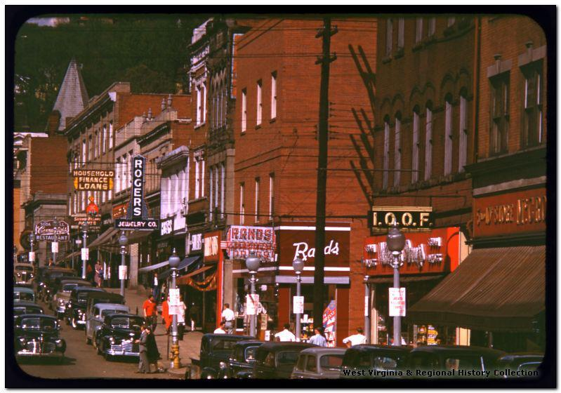unsolvedmistery:  High Street 1949. Photo Courtesy of the West Virginia Regional Archives of WVU   Morgantown, what happened to you?    Twenty five thumbs up, at least. Also, note the presence of the I.O.O.F. Building, which still has a sign up (above BW3).