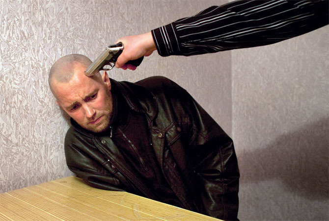"See Donald Weber's Brutal Ukranian Interrogation Photos in Person in NYC  Donald Weber is one of our favorite photographers. In addition to traveling the world and shooting for every publication that matters and winning a Guggenheim Fellowship and Lange-Taylor documentary prize, he recently put out an amazing photo book, Interrogations (Schilt Publishing, 2011), that documents the psychologically humiliating interrogations of Ukraine's petty criminals. The crimes of the accused are listed underneath their photos. If you can look at this kind of raw human shame and perverse humiliation without cringing, you're probably a corrections officer or in the CIA. In regards to the photos, Donald said, ""Without confessions, courts everywhere would grind to a halt in an instant; more than 90 percent of all charges in the Russian and Ukrainian judicial systems end in guilty pleas, and only experienced criminals and highly educated defendants stand a chance. This is what the cops are doing behind their closed doors—the feudal system's trial by ordeal is still much with us."" Donald will be having an opening reception for Interrogationstonight at the Foley gallery in New York City, and the photos will be remain on display through the end of May. In anticipation of his big fancy opening, we sat down to talk to him about spending nearly a year hanging out in dirty Ukrainian police stations, watching people get beat up, Sharpied, and pistol-whipped.   VICE: These were all from Ukraine, right? Donald Weber: Yeah, exactly. It was in 2010 and 2011. I made two separate trips for three or four months each in the winter time. How did you even know or stumble upon this? Through the police?My very first trip was in 2005. I met the policeman who ended up becoming my guide into the criminal world. Over the next five years, I got to know him more and more and began to understand the idea of criminality and how it works. That's basically how I came up with the idea of doing an interrogation. It took me two or three years when I had the idea and then another two years to convince him to let me photograph. How did you meet him in Ukraine?It was my very first trip to the Ukraine. I didn't have much to do and my friend said, ""I know a policeman. Why don't you go meet him?"" That night he was going on a raid, and he asked me to come along to see what it was like. From there, I always maintained contact with him. Every time I'd go to the Ukraine, I would see him and go out. For one of my very first projects, he was a key component for introducing me to certain types of people. What kind of people?Kind of gangster dudes. Just low-level Mafia guys. Nothing serious. What did you think of his character?He is an incredibly conflicted character, I think. In one aspect, I'd hear him talking to criminals in Fenya—the language that criminals speak—and then he would call either his mom, wife, or his daughter and he'd be very goody-goody. He'd say, ""Oh hi, Mommy! I love you and miss you so much!"" There were these dual characters about him. Continue"
