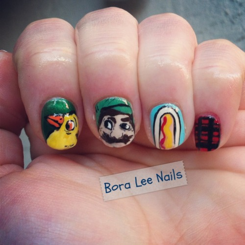 kasnailsandsuch:  boraleenails: Confederacy of Dunces nails! I think these are my personal favorite so far. If you haven't read this hilarious book by the late John Kennedy Toole, get on it! Here is a parrot, Ignatius J. Rilley, a hot dog, and plaid.  I've never read it, but these nails completely inspire me. Thanks for the book recommendation! (And the parrot's look in his eye is awesomely terrifying.)