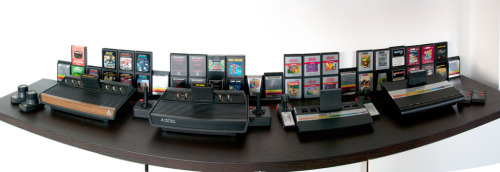 Atari Console Collection  L to R: Atari VCS (woodgrain), Atari 2600 (black), Atari 2600 Junior (rainbow) and the Atari 7800. Image by Thomas U.