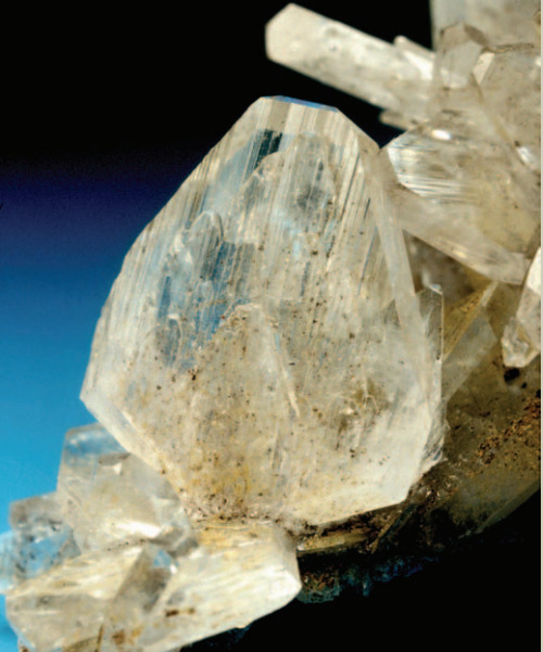 Hemimorphite, Zn4Si2O7(OH)2·H2O, is named for the crystallographic phenomenon it exemplifies. A hemimorphic crystal is one whose opposite faces are symmetrically inequivalent.