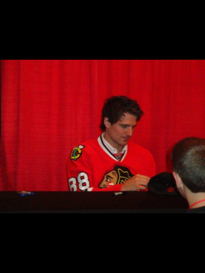 emmascrazyworld:  Remember that one time at the hawks convention when patrick sharp had to wear kaners jersey because he lost a bet?  WOW. JUST. WOOOOOW.