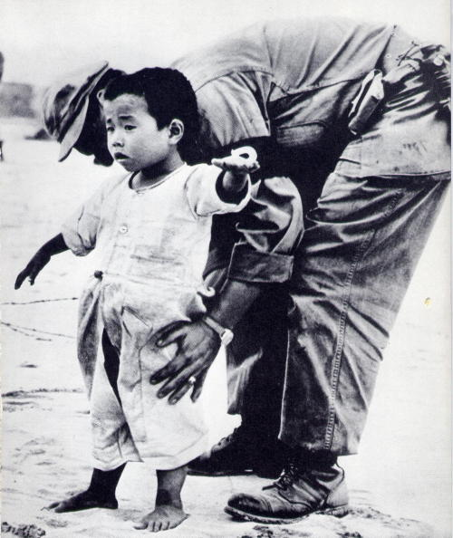 firsttimeuser:  Unknown AP photographer, Korean Refugee Child being searched for Weapon Children of Many Lands