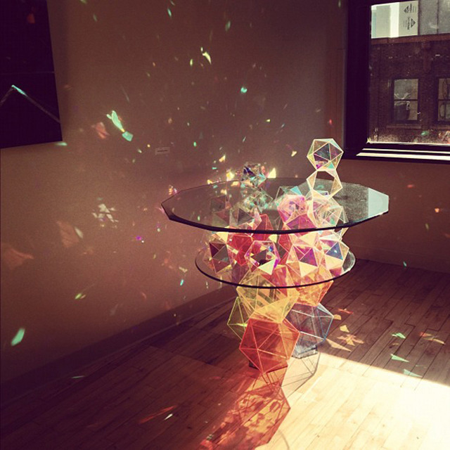 "travelingcolors:  Sparkle Geometric Table (by John Foster)  John Fosters invites us to discover ""Sparkle Palace Geometric Table"", a creation of glass with multiple light reflections. The table, thinking on the basis of an inverted pyramid made ​​of colored glass crystal offers a colorful rendering of the most successful to discover images in the future."