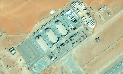 These satellite images show a remote airstrip deep in the desert of Saudi Arabia. It may or may not be the secret U.S. drone base revealed by reporters earlier this week. But the base's hangars bear a remarkable resemblance to similar structures found on other American drone outposts. And its remote location — dozens of miles from the nearest highway, and farther still to the nearest town – suggests that this may be more than the average civilian airstrip. [via Danger Room]