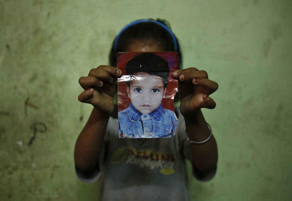 "fotojournalismus:  India's Missing Daughters (via Reuters' Photographers Blog) By Mansi Thapliyal ""Atika, 10, woke up early one morning in August 2008 and was sent by her mother to buy a few items from a nearby shop. She returned and told her mother she would prepare tea for her father before quickly going to use a communal toilet close to her house. She never returned. Ambika was a feisty 15-year-old high school student who took wrestling classes. Her mother returned home from work late in the night on October 10, 2010. She woke up the next morning and found her daughter missing. Atika and Ambika are among the thousands of children who go missing from India's streets, schools and homes every year. Following the case of a 5-year-old girl in Delhi who went missing and was then allegedly raped by a neighbor, I chose to find out what happens to girls who go missing and the struggles their parents go through to find them. According to a report by Delhi-based child rights NGO Bachpan Bachao Andolan, from January 1, 2013-April 20, 2013 there has been approximately 680 cases of missing children in Delhi, 65 percent of whom are girls. In most cases girls are either forced into the sex trade or trafficked to placement agencies to work as domestic workers. For four days, I met parents of girls who had gone missing. Every story was different, every story was equally sad. I spent hours with them, listening to their harrowing tales, understanding the grief and misery these families were going through. Only then did I turn my camera on to take pictures. Despite retelling their stories again and again over many years to hundreds of people, the mothers I met still cried their eyes out for their missing daughters when they spoke to me. For four days, I met parents of girls who had gone missing. Every story was different, every story was equally sad. I spent hours with them, listening to their harrowing tales, understanding the grief and misery these families were going through. Only then did I turn my camera on to take pictures. Despite retelling their stories again and again over many years to hundreds of people, the mothers I met still cried their eyes out for their missing daughters when they spoke to me. The family of Tyaba, who went missing in Delhi at the age of three in 2009, have searched across the country, visiting adoption homes, red light districts and orphanages in all of India's major cities. Other families, however, simply don't have the means to actively look for their missing daughters, like Mamta's family from Bihar, India's poorest state, who work in Delhi as laborers. They lost their seven-year-old daughter Bharti in April this year. Living on a construction site where they work, they earn around $4 a day and have to rely on the police, who have a reputation for being inactive and corrupt when handling such cases. I found that parents were keeping memories of their missing daughters alive through the objects left behind. The mother of Atika, the 10-year-old who went missing in 2008, continues to stitch embroidery for her daughter's ""bistra"" – a bedsheet gifted to Muslim brides on their wedding day – hoping that one day she'll return. Nothing can surpass the agony and desperation that has become their lives. The haunted looks on their faces speak of pain which is beyond all comprehension. I'm not sure if my pictures will bring these missing daughters back to their parents, but maybe they'll make people stop and think about the next time they see a girl begging on the side of the street or a young maid working inside a home. It's time to stop being silent spectators and take steps in the right direction or else who knows if the nightmare might come knocking on our doors…"""