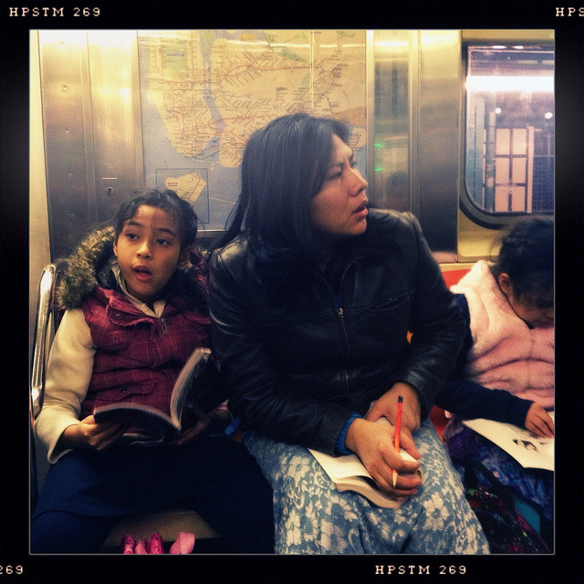 mother and daughters on 7 train. on Flickr.A mother and her two daughters reading and doing puzzles on the evening commute on the 7 train.