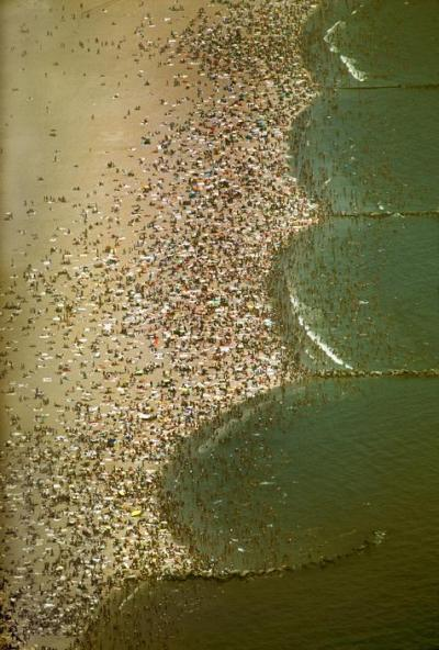 vahc:  USA. New York City. 1983. The Coney Island beach on a July weekend by Thomas Hoepker