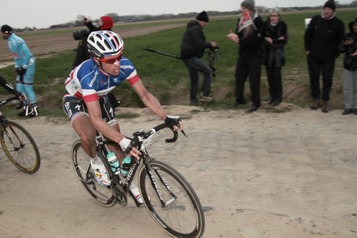 Sylvain Chavanel | Paris-Roubaix 2012 on Flickr.Via Flickr: Paris–Roubaix is a one-day professional bicycle road race in northern France near the Belgian frontier. From its beginning in 1896 until 1967 it started in Paris and ended in Roubaix (hence the name); since 1968 the start city has been Compiègne (about 60 kilometres (37 mi) north-east from Paris center) whilst the finish is still in Roubaix. Famous for rough terrain and cobblestones (setts),[n 1] it is one of the 'Monuments' or Classics of the European calendar, and contributes points towards the UCI World Ranking. It has been called the Hell of the North, a Sunday in Hell (also the title of a film about the 1976 edition of the race), the Queen of the Classics or la Pascale: the Easter race.[1] The race is organised by the media group Amaury Sport Organisation annually in mid-April. First run in 1896, Paris–Roubaix is one of cycling's oldest races. It is well known for the many 'cobbled sectors' over which it runs, being considered, along with the Ronde van Vlaanderen and Gent–Wevelgem to be one of the cobbled classics. Since 1977, the winner of Paris–Roubaix has received a sett (cobble stone) as part of his prize.[2] In recent years, the terrain over which Paris–Roubaix runs has led to specialized bikes, with unique frames and wheels, being used. Wheel punctures and other mechanical problems are extremely common because of this terrain, and often play a part in who is able to ultimately make it to Roubaix with momentum. Despite the high esteem with which the race is seen, some notable cyclists throughout history have regarded the race as a joke because of its difficult conditions. The race has also seen several controversies over the years, with many seeming winners of the race disqualified for various reasons. The course is maintained by Les Amis de Paris–Roubaix, a group of fans of the race formed in 1983. The forçats du pavé seek to keep the course as safe as possible for riders while maintaining its difficulty.