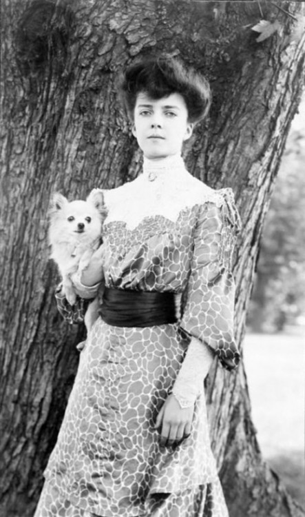 "Alice Roosevelt with her dog Leo - 1902  She smoked cigarettes in public, chewed gum, placed bets with bookies, rode in cars with men, stayed out late partying, and kept a pet snake named Emily Spinach, which she often wore wrapped around one arm and took to parties.  Her father President Theodore Roosevelt once said of her ""I can either run the country or I can attend to Alice, but I cannot possibly do both."""