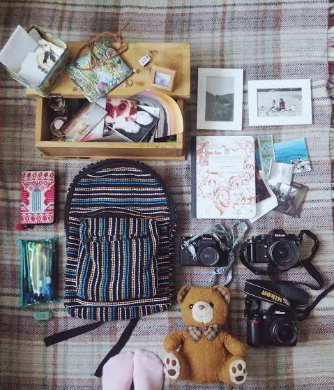 "Name: Pylin Manchee Age: 18  Location: Suffolk, England  Occupation: Art Student pylinmanchee.tumblr.com  List:  I tried to go for things that are sentimental therefore unable to be re-purchased. Wooden box filled with special lil' bits and bobs, photographs and memorabilia etc old photographs of myself with my parents wallet/purse - ID, bank card emergency money! - Not so sentimental but fairly practical. pencil case with certain pens and pencils that I've grown attached to a reallllllllly great rubber  Rucksack - once again, less sentimental more practical  Zenit Camera, It's got undeveloped photographs inside and I'm dying to find out what they look like Manual 35mm Nikon - Dad's old camera  Nikon D70s - the actual love of my life Scrap book/Diary - Filled with only good/happy/important things Teddy Bear named ""B"" - we all have that one teddy that's been around for as long as one can remember…"