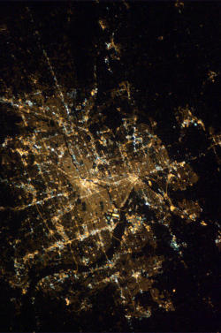 stuffaboutminneapolis:  Hello Twin Cities – you looked beautiful just before sunrise yesterday  International Space Station Astronaut Thomas Mashburn uploaded this pic of the Twin Cities to his Twitter account yesterday.