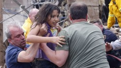 Photo of the Day: Child Saved from Oklahoma Tornado Elementary School Rubble