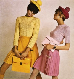 updownsmilefrown:  Twiggy (right) modeling a pleated skirt, 1966