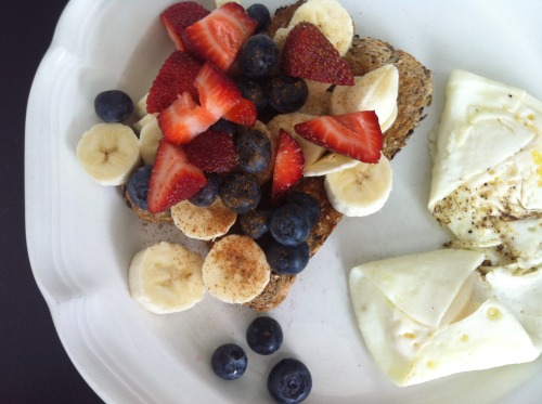 Breakfast: Eggs and Good Seed toast topped with fruit and cinnamon!