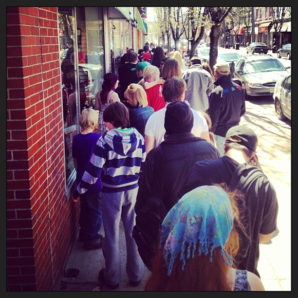 The line up at #StrangeAdventures for #freecomicbookday! If any more kids join the #family in front of me, I'm gonna start throwing them into #traffic. Kids first, then parents, whom I assume will put up way less of a fight when confronted with unfathomable grief and… OMFG IT SMELLS LIKE ONE OF THEM JUST SHIT THEMSELVES! Like, they must be at least 7 or 8 years old, wtf?!