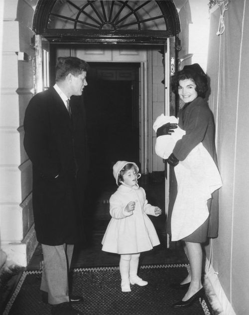The Kennedy Family returns from Palm Beach President and Jacqueline Kennedy with their children, Caroline and John, Jr., at the south entrance of the White House.  The First Family had just returned from a trip to Palm Beach, Florida. 2/4/61. from the JFK Library