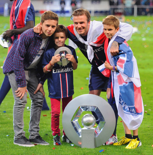 David Beckham played his last-ever home game this weekend before retiring from soccer, and the whole family was on hand to support him. It's interesting how much these kids look up to their father — wearing his jersey, not being embarrassed to have their picture taken with him. I wonder what that's like.