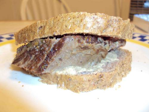 Same meal as yesterday!  Grass-fed brisket sandwich with homemade caveman ketchup and organic mustard on paleo almond butter bread.  When something's this good, it's a shame to only eat it once. By the way, you can't see the back of this sandwich, because I devoured it before talking a photo.  And the best part, I still have another day or two of leftovers!