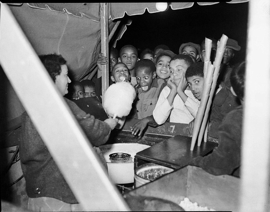 "Charles ""Teenie"" Harris: Children at cotton candy booth, possibly at Westview Park."