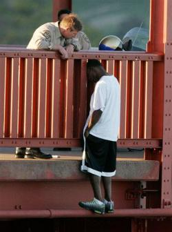 "suicideisnotanoption4u:  8-years ago, CHP Officer Kevin Briggs talked this young man out of jumping off the Golden Gate Bridge. That young man's name is Kevin Berthia. Today he is 30 years old and married with 2 children. This week he presented Officer Briggs with an award on behalf of the American Foundation for Suicide Prevention. The story of how Officer Briggs talked Kevin down is remarkable. As you can see in the picture, Kevin is literally one step away from jumping to his death. But for more than hour, the officer listened to Kevin pour his heart out about his troubles and told him, ""I know you think things are bad, but they can get better.""Kevin says, ""Officer Briggs never made me feel guilty for the situation I was in. He made feel like, I understand why you are here, but there are alternatives""Kevin is just one of countless lives Briggs has saved over his 23 year career.Briggs, who was promoted to Sergeant five years ago, is humble about what he does. He says, ""they make the decision, when they step back over that rail it takes a tremendous amount of courage""I salute Sergeant Briggs!Photo: The San Francisco Chronicle, John Storey  Saw a documentary about Sergeant Briggs, he's a really inspiring guy."