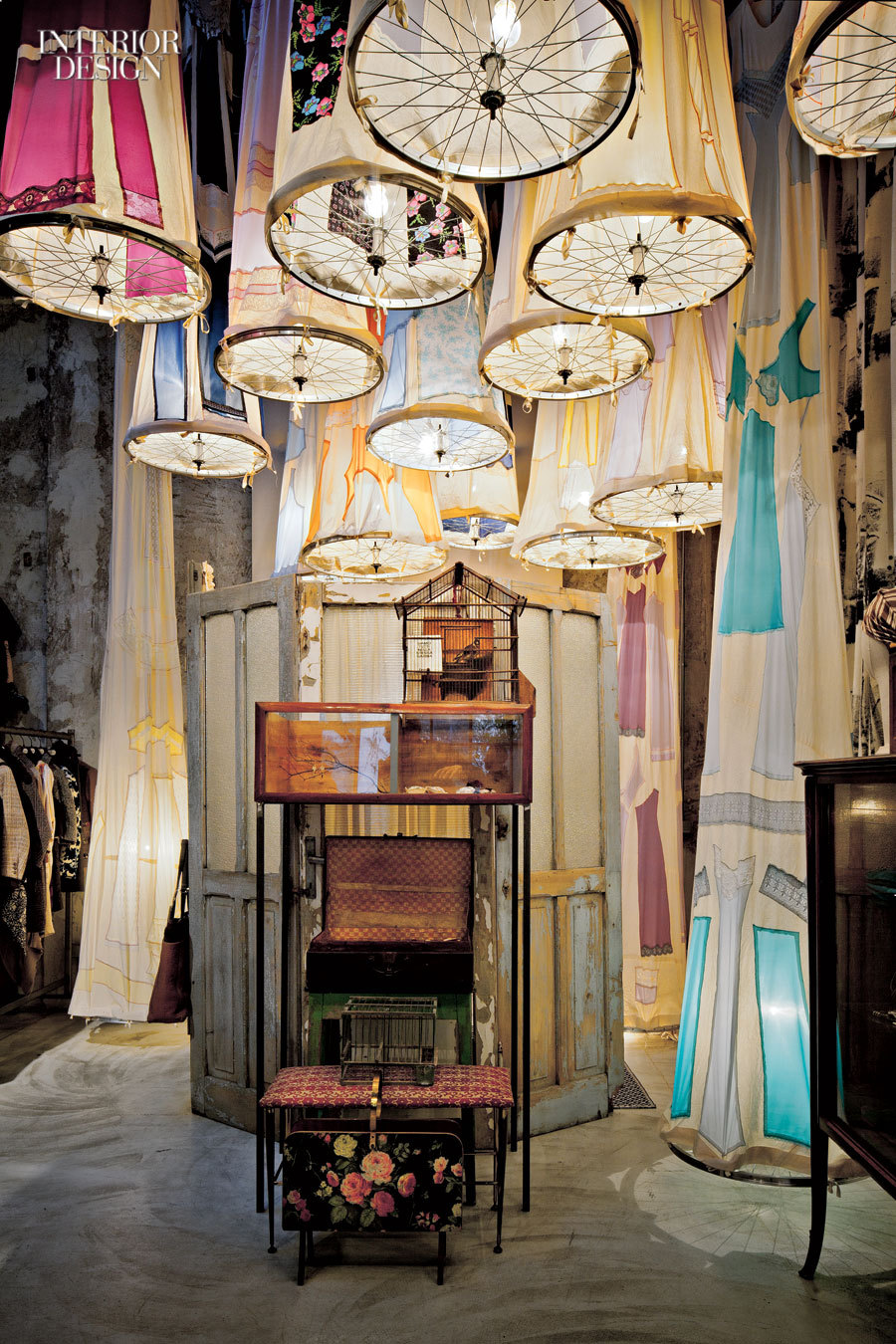 Grandma's attic goes surreal with pendant fixtures fashioned from vintage petticoats and bicycle wheels at Antonio Marras, occupying a former auto-repair shop in Milan. Photography by Bamberghi/Photofoyer. Go here for a global tour of luxe retail design.