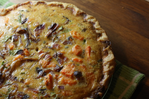 The amazing thing about quiche — you can make it as fancy or as simple as you want, and it will always come out amazing. This quiche was a fancy experiment — carmelized onion, candied bacon, sweet potato, arugula from the garden, and deliciously curdled cream.